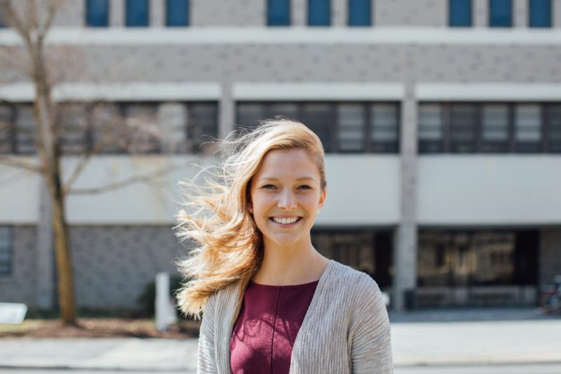 Megan Godsey in front of Wallace Hall
